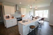Traditional Style House Plan - 4 Beds 3.5 Baths 2754 Sq/Ft Plan #898-29 Interior - Kitchen