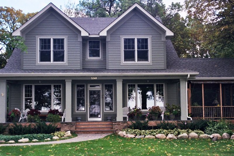 Dream House Plan - Farmhouse Exterior - Front Elevation Plan #51-306