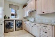 European Style House Plan - 4 Beds 5.5 Baths 6594 Sq/Ft Plan #930-516 Interior - Laundry