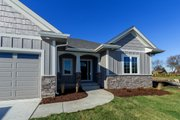 Ranch Style House Plan - 4 Beds 3 Baths 1703 Sq/Ft Plan #70-1500 Exterior - Front Elevation