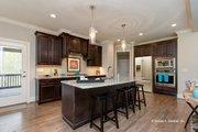 Craftsman Style House Plan - 4 Beds 3 Baths 2498 Sq/Ft Plan #929-973 Interior - Kitchen
