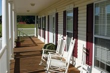 Farmhouse Exterior - Covered Porch Plan #56-205
