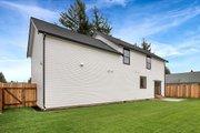 Farmhouse Style House Plan - 3 Beds 2.5 Baths 1840 Sq/Ft Plan #1070-1 Exterior - Rear Elevation