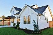Farmhouse Style House Plan - 3 Beds 2.5 Baths 2038 Sq/Ft Plan #1070-2 Exterior - Rear Elevation