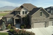 Traditional Style House Plan - 4 Beds 3.5 Baths 5212 Sq/Ft Plan #1060-69 Exterior - Front Elevation
