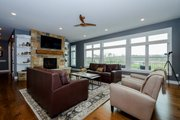 Ranch Style House Plan - 4 Beds 4 Baths 2609 Sq/Ft Plan #70-1501 Interior - Family Room