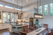 Contemporary Style House Plan - 4 Beds 4 Baths 3349 Sq/Ft Plan #935-14 Interior - Dining Room