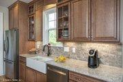 Craftsman Style House Plan - 3 Beds 2.5 Baths 2592 Sq/Ft Plan #929-833 Interior - Kitchen