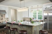 Bungalow Style House Plan - 3 Beds 2.5 Baths 2904 Sq/Ft Plan #928-330 Interior - Kitchen