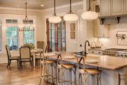 Country Style House Plan - 4 Beds 4.5 Baths 4852 Sq/Ft Plan #928-1 Interior - Kitchen