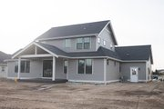 Craftsman Style House Plan - 4 Beds 2.5 Baths 2521 Sq/Ft Plan #1070-35 Exterior - Rear Elevation