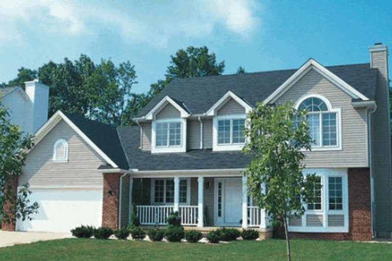 Traditional Style House Plan - 3 Beds 2.5 Baths 1998 Sq/Ft Plan #20-215 Exterior - Front Elevation