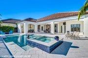 Mediterranean Style House Plan - 3 Beds 3.5 Baths 3700 Sq/Ft Plan #930-511 Exterior - Rear Elevation