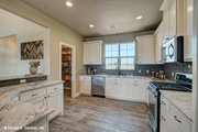 Ranch Style House Plan - 3 Beds 2 Baths 1818 Sq/Ft Plan #929-1002 Interior - Kitchen