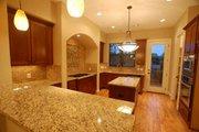 Mediterranean Style House Plan - 3 Beds 3.5 Baths 2375 Sq/Ft Plan #449-19 Interior - Kitchen