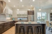 Contemporary Style House Plan - 4 Beds 3 Baths 3133 Sq/Ft Plan #1066-49 Interior - Kitchen