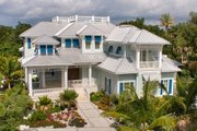 Beach Style House Plan - 5 Beds 6.5 Baths 8791 Sq/Ft Plan #27-468 Exterior - Front Elevation