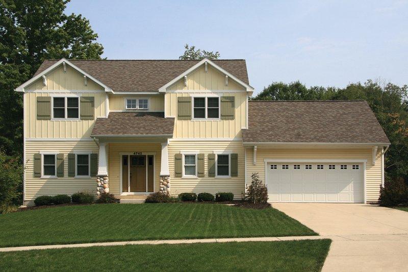 Farmhouse Exterior - Front Elevation Plan #928-6 - Houseplans.com