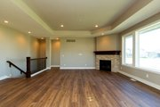 Ranch Style House Plan - 4 Beds 3 Baths 1703 Sq/Ft Plan #70-1500 Interior - Family Room