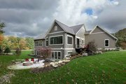 Craftsman Style House Plan - 3 Beds 3.5 Baths 4135 Sq/Ft Plan #928-318 Exterior - Rear Elevation