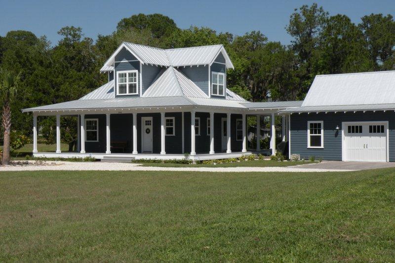 Farmhouse Exterior - Front Elevation Plan #64-208 - Houseplans.com