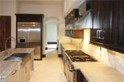 Mediterranean Style House Plan - 3 Beds 4 Baths 4472 Sq/Ft Plan #449-18 Interior - Kitchen