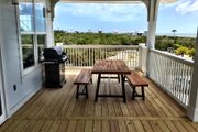 Beach Style House Plan - 4 Beds 2.5 Baths 2593 Sq/Ft Plan #901-118 Exterior - Outdoor Living