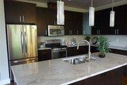Prairie Style House Plan - 3 Beds 2.5 Baths 2579 Sq/Ft Plan #124-924 Interior - Kitchen