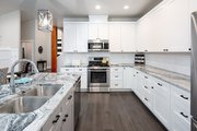 Contemporary Style House Plan - 3 Beds 2.5 Baths 2116 Sq/Ft Plan #1070-30 Interior - Kitchen