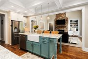 Country Style House Plan - 4 Beds 3.5 Baths 2834 Sq/Ft Plan #927-942 Interior - Kitchen