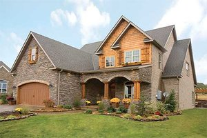 Traditional home with Craftsman details elevation photo