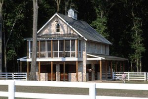 Country barn for horses with living space elevation