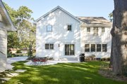 Traditional Style House Plan - 5 Beds 3.5 Baths 4834 Sq/Ft Plan #928-349 Exterior - Rear Elevation